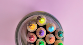 Image of Different coloured pencils in a pencil holder